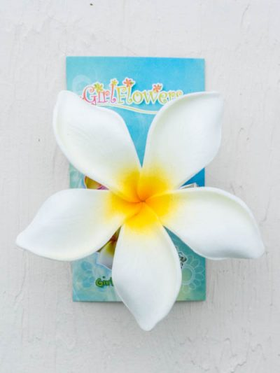 Large pink frangipani hair clip , 3 1/2 inches diameter x 1/2 inch deep. The flower is securely attached to a 1 3/4 inch metal alligator hair clip and will hold well in thin or thick hair.